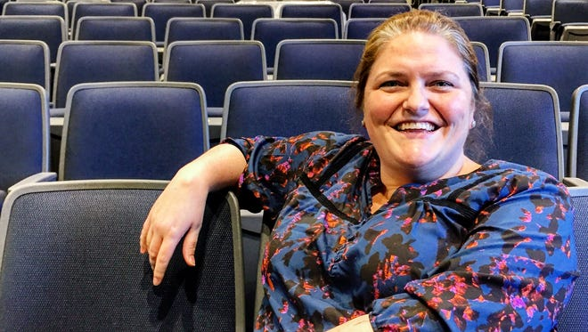 """Kim Calhoun, director of arts and performing arts at School of the Holy Child in Rye, sits in the newly created theater, which has state-of-the-art lighting and sound equipment and will host """"The Wizard of Oz"""" Feb. 26 and 27."""