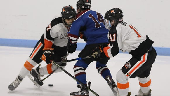 Rye Town/Harrison's Jack Shapiro is checked by Mamaroneck's
