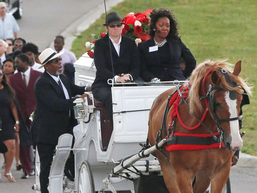 Valerie Castile, right, rides in the horse-drawn carriage