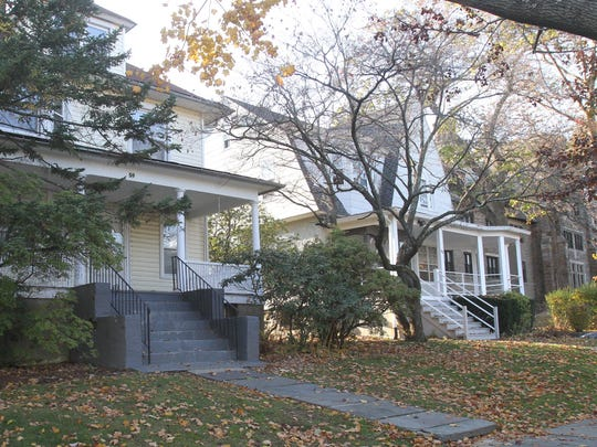 From left, 59 and 55 Leland Avenue in New Rochelle are two homes being auctioned off by the College of New Rochelle Nov. 16, 2016. The college is auctioning off the houses to help pay for their recently-discovered financial issues.