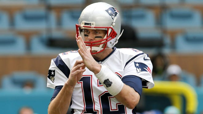 Patriots quarterback Tom Brady outlines his fitness regimen in a new book.