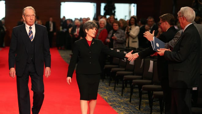 Sens. Chuck Grassley and Joni Ernst walk the red carpet during inaugural events in this file photo from January 2017.