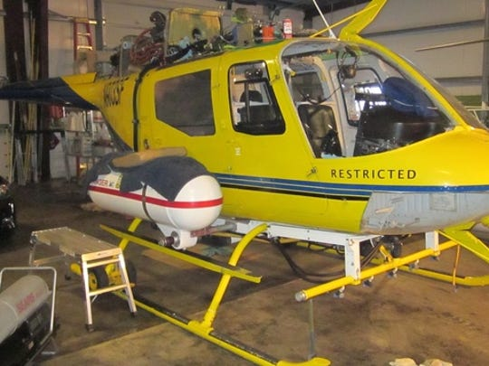 The yellow helicopter belonging to Steve Owen of Pacific Air Research was at the center of an investigation into alleged overspray during an aerial herbicide application onto forestland in Curry County.