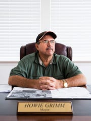 Mayor Howie Grimm poses for a portrait at his office in City Hall in Everglades City on Thursday, July 19, 2018.