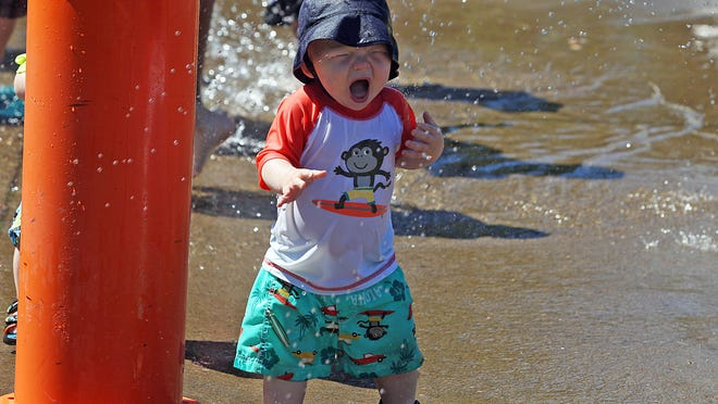 Thirteen-month-old Jace Guenther reacts to a splash of water in the splash pad at Wes Bennett Park in south Salem Monday, June 30, 2014.