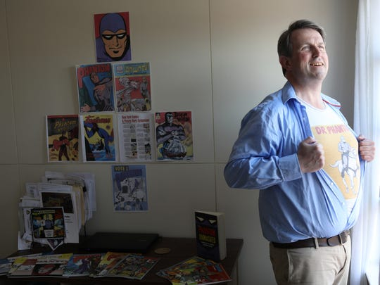 """Kevin Patrick poses for a photo in his Glen Rock apartment. Patrick wrote a book called, """"The Phantom Unmasked: America's First Superhero"""". Thursday, May 3, 2018"""