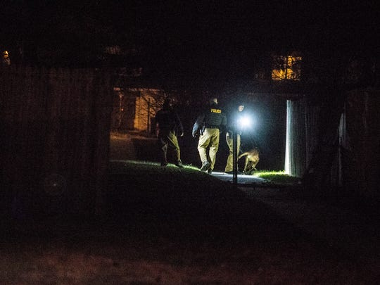 New Castle County police use a k-9 during an investigation at the scene of a shooting Wednesday night on Freedom Trail in New Castle.