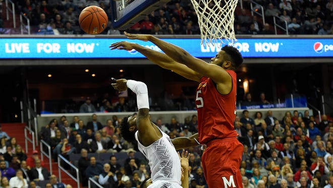 Maryland Terrapins forward Damonte Dodd (35) blocks Georgetown Hoyas guard Tre Campbell (1) shot during the second half at Verizon Center.