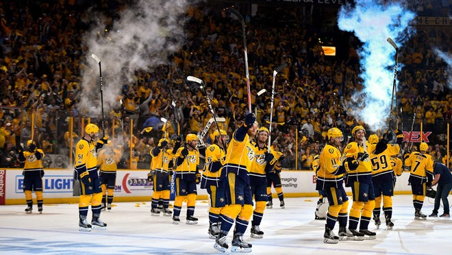 The Predators celebrate after defeating the Chicago Blackhawks in Game 4 of the first round the NHL playoff series at Bridgestone Arena on Thursday, April 20, 2017.