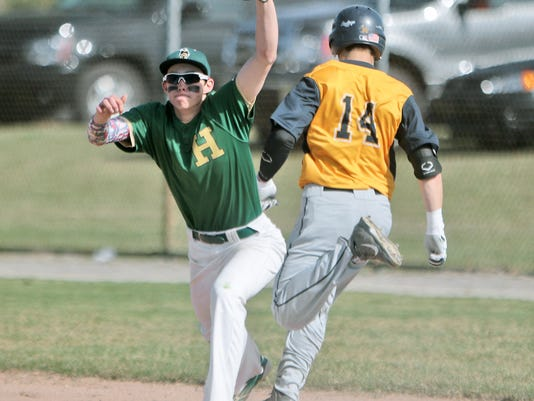 Howells Austin Palo stretches to get Hartlands Brett Oliver at 1st base.jpg