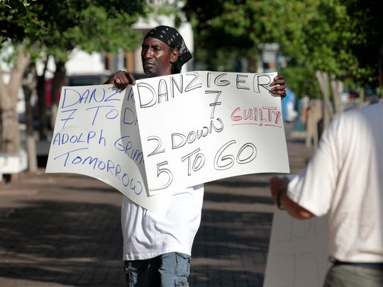 Tabari Simpson protests outside federal court in New