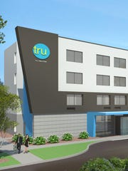 The exterior design of a Tru by Hilton hotel.