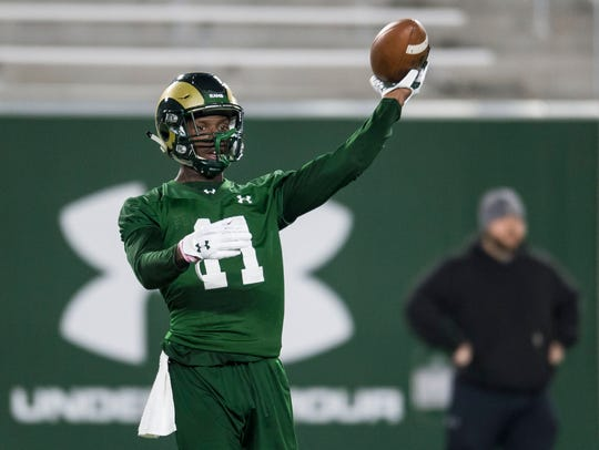 CSU receiver Preston Williams tosses a football during a March 19 practice at the Rams' stadium.