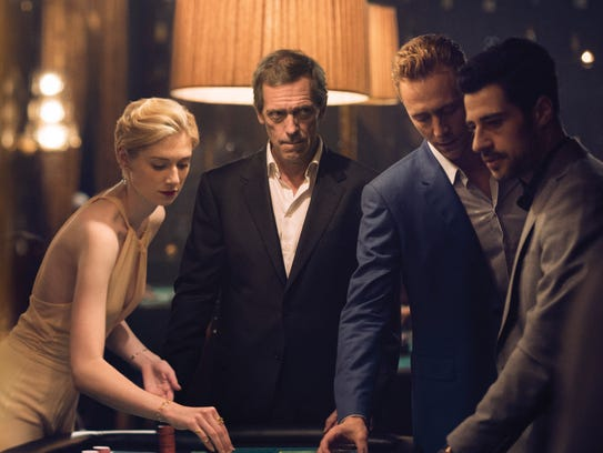 Elizabeth Debicki, left, Hugh Laurie and Tom Hiddleston