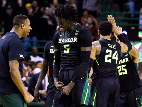 Baylor Bears forward Johnathan Motley (5) flexes his