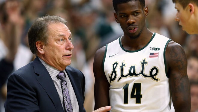 Tom Izzo talks to Spartans guard Eron Harris and guard Matt McQuaid  during the second half of a game at Jack Breslin Student Events Center. MSU won 71-67.