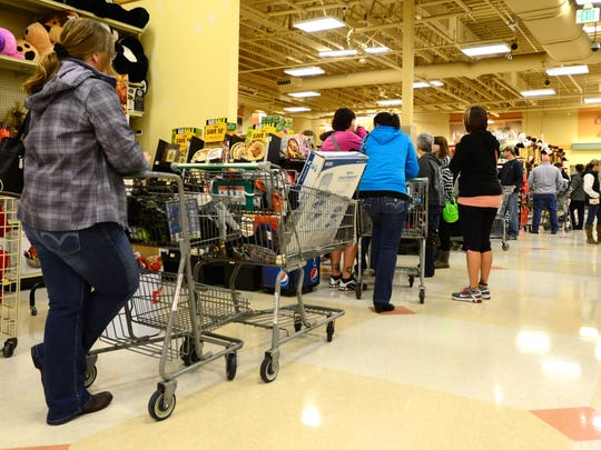 Shoppers wait in line to check out at the South Salem Fred Meyer on Black Friday, Nov. 28, 2014.
