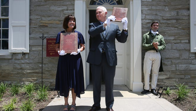 Indiana Governor Mike Pence, right, and First Lady Karen Pence hold the orginal Indiana state constitutions during a bicentennial celebration at the old State Capitol in Corydon, Indiana.June 29, 2016