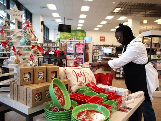 Store associate Paula Jones arranges a display in LifeWay