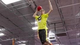 Dakota Hillard, 16, jumps high on the trampoline at Sky Zone in Fort Myers as he prepares for a slam dunk during teen night.