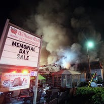 Firefighters from several departments assist East Fishkill firefighters in battling a blaze that destroyed William Tell Hardware on Route 82 in Hopewell Junction late Saturday night