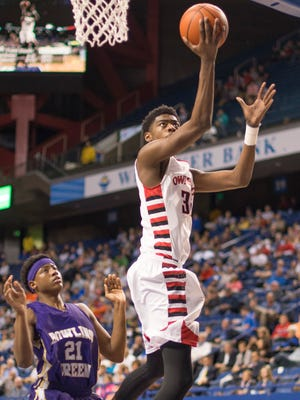 Owensboro's Aric Holman slips past Bowling Green's Terry Tayor (21) for an easy layup during his team's 74-58 win Sunday, March 22, 2015, in the KHSAA Boys' Sweet Sixteen Basketball Tournament championship game in Lexington, Ky. (AP Photo/John Flavell)