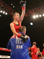 Boxer Jennifer Han acknowledged her fans as trainer Louie Burke carried her around the boxing rinng at the conclusion of her match against Olivia Gerula Friday night.