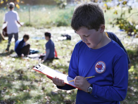 Matthew Gandrud, 11, makes notes during the water case