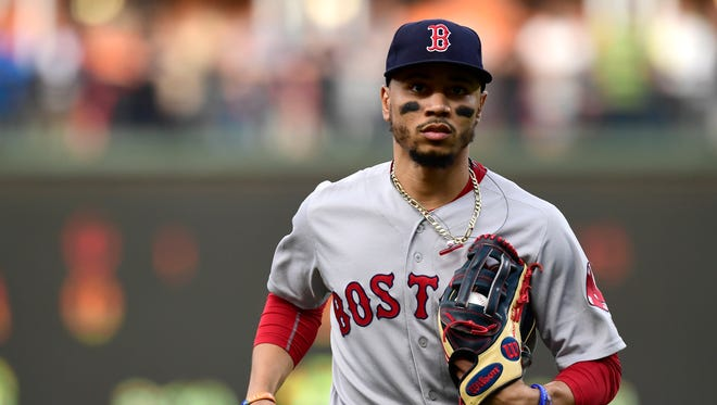 Mookie Betts leads the majors with a .359 batting average.