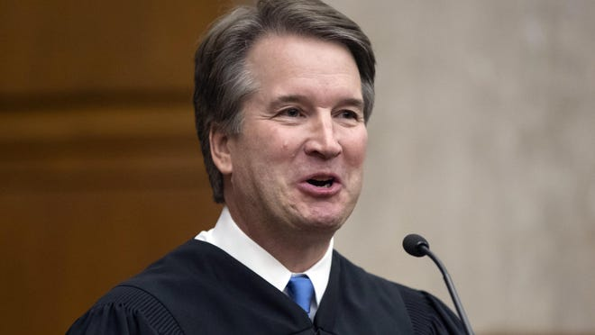 FILE - In this Aug. 7, 2018, file photo, President Donald Trump's Supreme Court nominee, Judge Brett Kavanaugh, officiates at the swearing-in of Judge Britt Grant to take a seat on the U.S. Court of Appeals for the Eleventh Circuit in Atlanta at the U.S. District Courthouse in Washington. SKavanaugh has frequently supported giving the government wide latitude in the name of national security, including the secret collection of personal data from Americans. (AP Photo/J. Scott Applewhite, File)