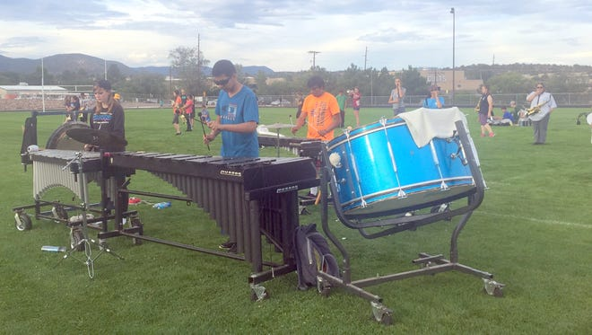 Members of the Silver High Fighting Colt Marching Band had some practice Monday evening at Fox Field.