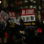 Wiley King and Angelica Serrano, both fast food employees in Des Moines, marched for $15 wages and a union on Thursday, Jan. 28, 2016.