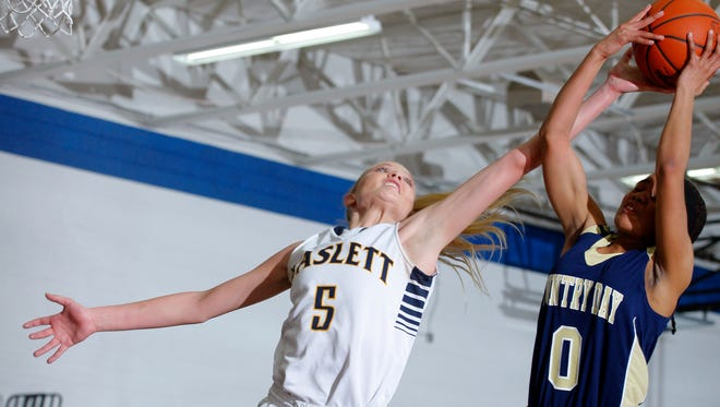Haslett's Karson Tripp, left, and Detroit Country Day's Kaela Webb (0) reach for a rebound Tuesday, Feb. 2, 2016, in Haslett, Mich. Country Day won 69-56.