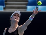 Canada's Eugenie Bouchard wipes the sweat from her face during her women's singles qualifying match against Italy's Martina Trevisan for the Australian Open tennis championship in Melbourne, Australia, Friday, Jan. 17, 2020. (AP Photo/Lee Jin-man)