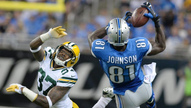 Packers cornerback Sam Shields (37) gives up a catch to Lions receiver Calvin Johnson.