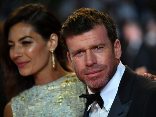 Taylor Sheridan and his wife, Nicole, attend the Cannes