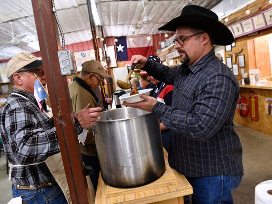 Lance Perry serves chili during Friday's celebration of Texas Independence at Merkel's Area Historical Museum. Perry is the new president of the museum.