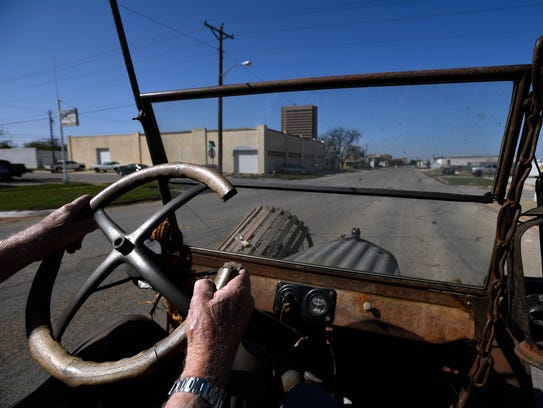 """Tim Eyssen drives his 1924 Model T on Oak Street in Abilene. The 94 year-old classic is one of a handful owned by Eyssen; specifically, """"six that run, and lots of parts."""" His """"Junk Truck"""" will be on display during Thursday's CarWalk in downtown Abilene."""