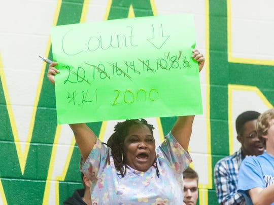 FAN OF THE WEEK: A family member of Mardela guard Demyra Selby celebrates Selby's 2000th against Wicomico on Thursday evening at Mardela High.