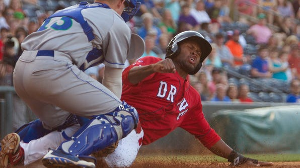 Greenville's Manuel Margot is tagged out at home Saturday at Fluor Field. Margot went 3-for-4 in the Drive's 5-1 win over Lexington.