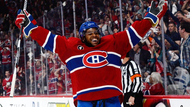 Montreal Canadiens forward Devante Smith-Pelly (21) celebrates after scoring a goal against the Tampa Bay Lightning during the first period in game five of the second round of the 2015 Stanley Cup Playoffs at the Bell Centre.