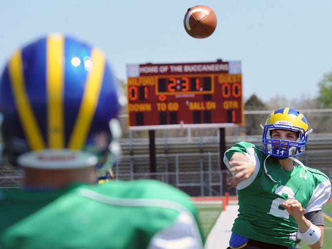 Delaware quarterback Trent Hurley warms up on the sidelines at spring practice Saturday.
