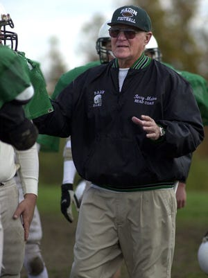 Terry Malone instructs his Badin High School football team in 2001.