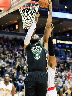 Bucks center Greg Monroe finished with 14 points and 10 rebounds in Milwaukee's victory over the Atlanta Hawks on Friday at the BMO Harris Bradley Center.