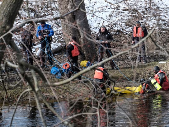Lansing police recover a body from the Grand River
