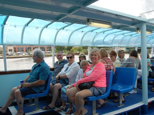 Lincoln High School 1976 grads cruise on the Skyline Princess charter boat in Manitowoc as part of their 40th reunion.