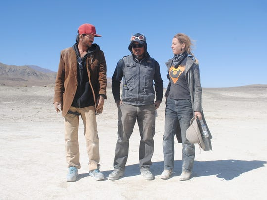 "Matthew ""Starchild"" Deluge (left), stands with Dominic ""D.A."" Tinio and Sandy ""Phoenix Firestarter"" Jungwirth, all lead members of the Resto crew for Burning Man."