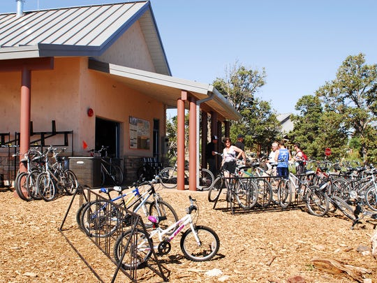 "Located next to the Grand Canyon National Park Visitor Center (South Rim), bicycle rental services are operated by Bright Angel Bicycles and offers daily guided bicycle tours and a ""grab and go"" food and beverage service targeted toward hikers, bikers and pedestrians."
