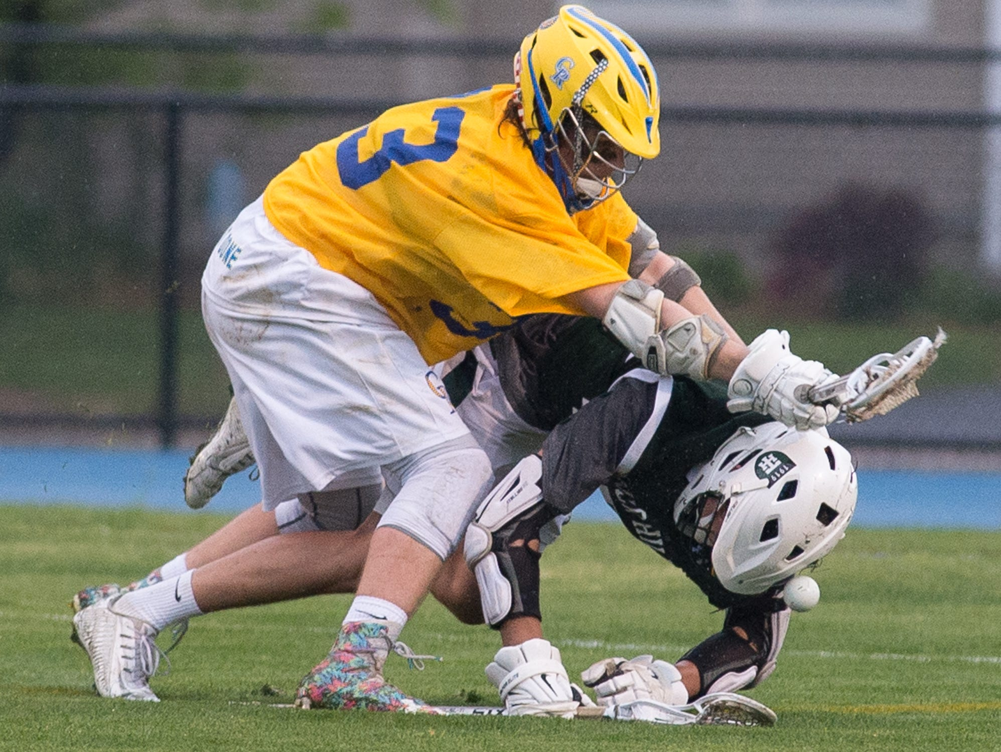 Caesar Rodney's Jacob Mollohan (33), left, with a hit to a Tower Hill player that ended in a penalty against Caesar Rodney.