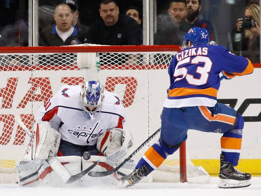 Washington Capitals goaltender Philipp Grubauer, of Germany, makes a save on New York Islanders center Casey Cizikas (53) during the first period of an NHL hockey game in New York, Thursday, March 15, 2018. (AP Photo/Kathy Willens)
